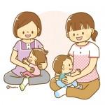 子どもを抱く保育士2名のイラスト