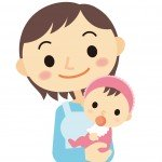 乳児を抱く保育士さん