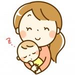 眠った幼児を抱く保育士さん